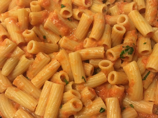 Rigatoni in a creamy vodka sauce and garnished with basil