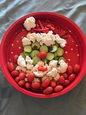 A tray full of veggies shaped like Santa