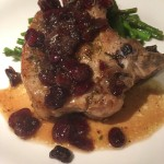 Brie-Stuffed Pork Chops in Cranberry Sauce